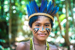 Native Brazilian boy at an indigenous tribe in the Amazon Stock Images