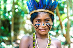 Native Brazilian boy at an indigenous tribe in the Amazon Royalty Free Stock Image