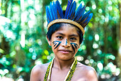 Native Brazilian boy at an indigenous tribe in the Amazon Stock Photos