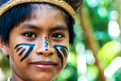 Native Brazilian boy at an indigenous tribe in the Amazon.  royalty free stock images