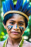 Native Brazilian boy at an indigenous tribe in the Amazon.  stock photos