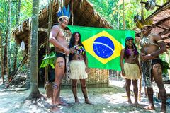 Native Brazilian family at an indigenous tribe in the Amazon.  Royalty Free Stock Image