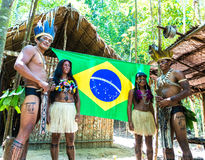 Native Brazilian family at an indigenous tribe in the Amazon Stock Photography