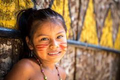 Native Brazilian girl smiling at an indigenous tribe in the Amazon.  stock photo