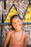 Native Brazilian girl smiling at an indigenous tribe in the Amazon.  stock photos