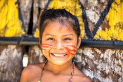 Native Brazilian girl smiling at an indigenous tribe in the Amazon Stock Images