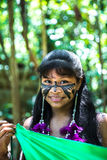 Native Brazilian girl smiling at an indigenous tribe in the Amazon Stock Photography