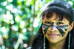 Native Brazilian girl smiling at an indigenous tribe in the Amazon.  stock photography