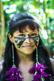 Native Brazilian girl smiling at an indigenous tribe in the Amazon.  royalty free stock photo