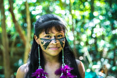 Native Brazilian girl smiling at an indigenous tribe in the Amazon Stock Photos