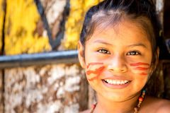 Native Brazilian girl smiling at an indigenous tribe in the Amazon.  royalty free stock photos