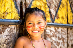 Native Brazilian girl smiling at an indigenous tribe in the Amazon Royalty Free Stock Image