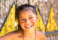 Native Brazilian girl smiling at an indigenous tribe in the Amazon.  Royalty Free Stock Photography