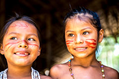 Native Brazilian girls at an indigenous tribe in the Amazon.  royalty free stock images