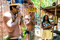 Native Brazilian group playing wooden flute at an indigenous tribe in the Amazon.  Royalty Free Stock Photography