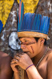 Native Brazilian guy playing wooden flute at an indigenous tribe in the Amazon Stock Photos