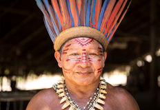 Native Brazilian man at an indigenous tribe in the Amazon.  Stock Photos