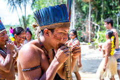 Native Brazilian people dancing at an indigenous tribe in the Amazon.  stock photography