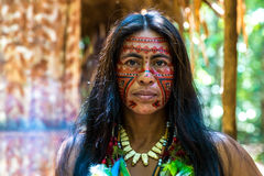 Native Brazilian woman at an indigenous tribe in the Amazon Stock Image