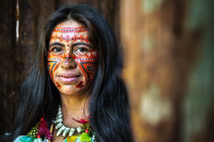 Native Brazilian woman smiling at an indigenous tribe in the Amazon Royalty Free Stock Image
