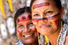 Native Brazilian women smiling at an indigenous tribe in the Amazon.  Stock Photos