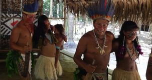 Native Brazilians doing their ritual at an indigenous tribe in the Amazon stock video