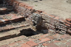 Native California Ruin. Examples of a Native Californian Ruin of a Stone Head at a Spanish Californian Mission Stock Photography
