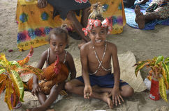 Native Children. Two natives children pose with their pet chock. Raising money for the school at the Market held on the lovely sandy beach of Champagne Bay Stock Photos