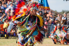 Native American Dancer. Beautiful choreography of Native American dancer at powwow Stock Image