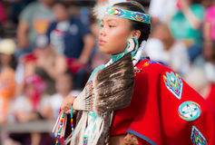 Native American Princess. Beautiful choreography of Native American dancer at powwow royalty free stock image
