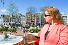 Native dutch woman drinking tea in Amsterdam the Ne. Native dutch woman drinking tea on a terrace in Amsterdam the Netherlands Royalty Free Stock Image