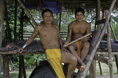 Native Embera Men, Panama. Dressed in native clothing and jewelry of the indigenous Embera people in the jungle of Panama, Central America,  near the Rio Chagres Royalty Free Stock Photo