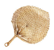 Native fan made from palm leaves on white Royalty Free Stock Photos