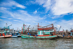 Native fisherman boat was park at Baan Pe pier Stock Photos