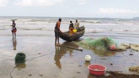 Native fishermen fishing on sea, using traditional technique pulling net