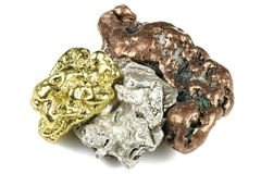 Gold, silver and copper nuggets. Native gold, silver and copper nuggets isolated on white background royalty free stock photos