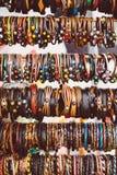 Native handcrafts colorful bracelets in market.  stock images