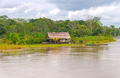 Native house along a rain forest river Stock Photos