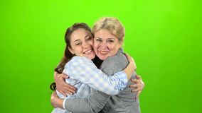 Native hugs, they are stand and talking. Green screen. Native hugs, they are stand mother and daughter are talking. Green screen stock footage