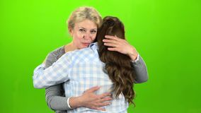 Native hugs, they are stand and talking. Mother hugs her daughter. Green screen.  stock video