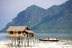 Native Hut and House Boat Stock Photo