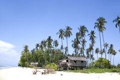 Native Huts on Tropical Island Royalty Free Stock Photos