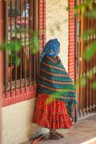 Native Indigenous old lady in colorful traditional dress, in Mexico, America. A Native Indigenous or Indian senior female with colorful traditional dress with royalty free stock photo