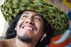 Native latino man with fresh handmade palm tree leaf hat. Portrait closeup of young native latino man with fresh handmade palm tree leaf hat stock image