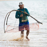Native local man nets in the sea, Thailand Stock Photography