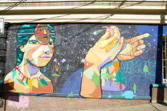 Native man graffiti. VALPARAISO - NOVEMBER 07: Native man graffiti in the districts of the protected UNESCO World Heritage Site of Valparaiso on November 7, 2015 stock photography