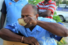 Native men celebrating occasion with traditional Kava drink,Fiji,2015. Three native men celebrating special occasion, drinking country's ground, sometimes Royalty Free Stock Photography