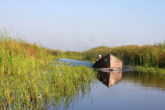 Native men from Danube Delta with fast boat Royalty Free Stock Image
