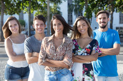 Native mexican girl with caucasian and latin men and woman. Native mexican girl with caucasian and latin men and women outdoor in the city in the summer Stock Photo