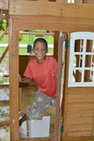 Native Nicaragua boy plays  child's playhouse in Corn Island,Nic Royalty Free Stock Photography